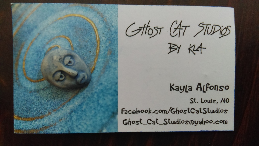 A little face pin by Kayla Alfonso of Ghost Cat Studios.