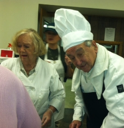 Gloria - Left and Jerry - right prepare Turkey as Chef Karen Looks on - Middle