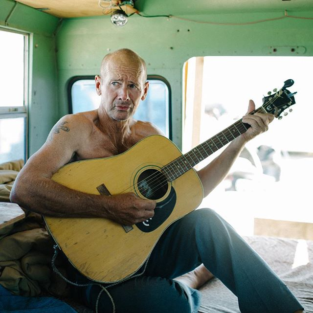 Slab City XX // Randall, who famously cooks the best catfish in Slab City, packed up life in Texas and took his bus on the road, accompanied by his beloved dog, fishing pole and guitar.