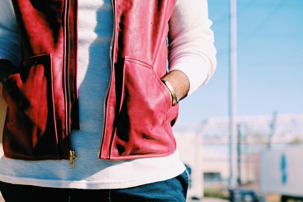 vest: santana social club; shirt: santana social club; sunglasses: tevin vincent; nola id bracelet: porter lyons; jeans: h&m; shoes: h&m
