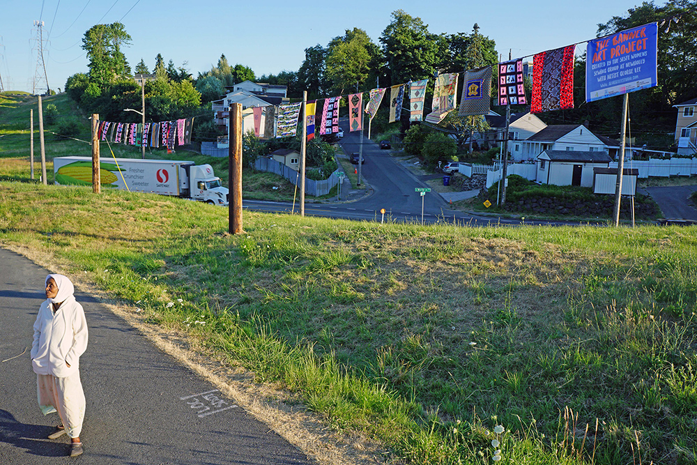 The Clothesline Banners - 2017230' x 6' x 15'$10,000Textile, Wood Utility Poles, Cord, Land, PeoplePublic Art @ Chief Sealth Trail, Seattle, WAKing County 4Culture, Somali Family Safety Task Force & Seattle City LightThe Clothesline Banner Project in NewHolly South Seattle is a social practice, sculpture piece created by the Somali Family Safety Task Force Womens Sewing Group at NewHolly with Artist George Lee. It is a 200' long string of quilt banners, held up 15' by (5) utility poles, along the Chief Sealth Multi Use trail, created by an East African Women's Sewing group. Funded by 4Culture, helped probono by engineers and contractors, and permitted by City Light to put this up on their right of way for 5 months.