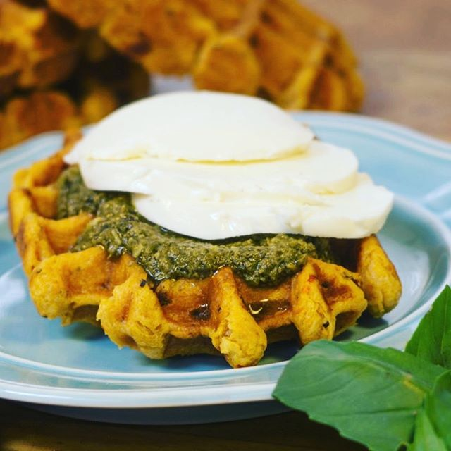 We're seeing green this week! ☘️ Try this savory #liegewaffle combo with basil pesto and fresh mozzarella cheese. #stpatricksday #food #pesto #cheese #green #waffles #basil #suitefoods
