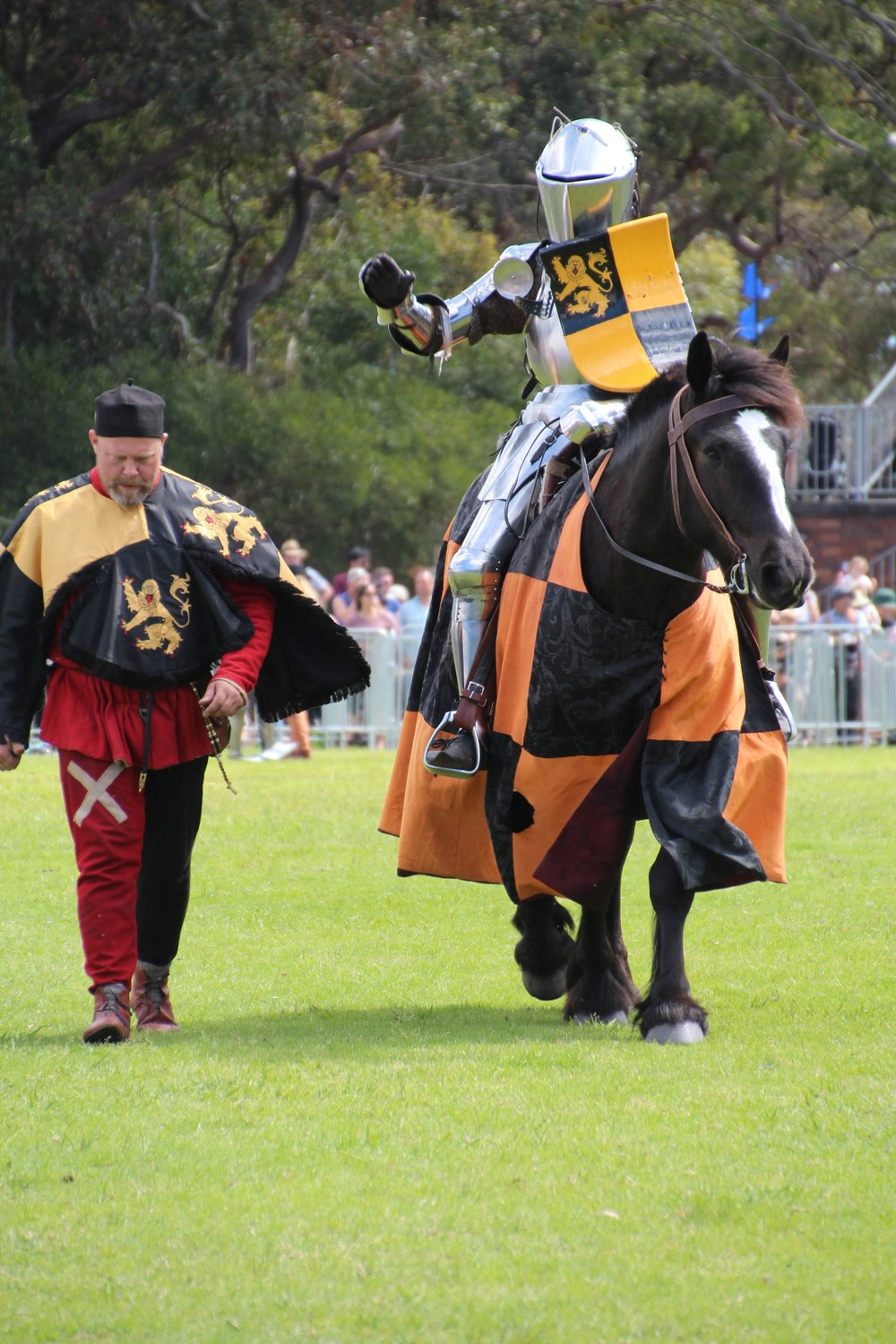One of the brave and talented knights with his squire and handsome steed, taking part in the Jousting at St Ives Medieval Faire.