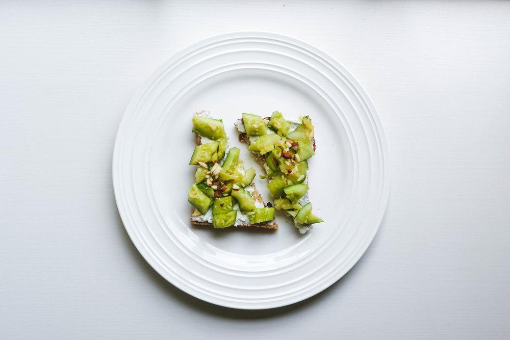 cucumber +garlic +sesame +soy +almonds* - *toasted, always.essentially my dad's garlic cucumber salad on toast.