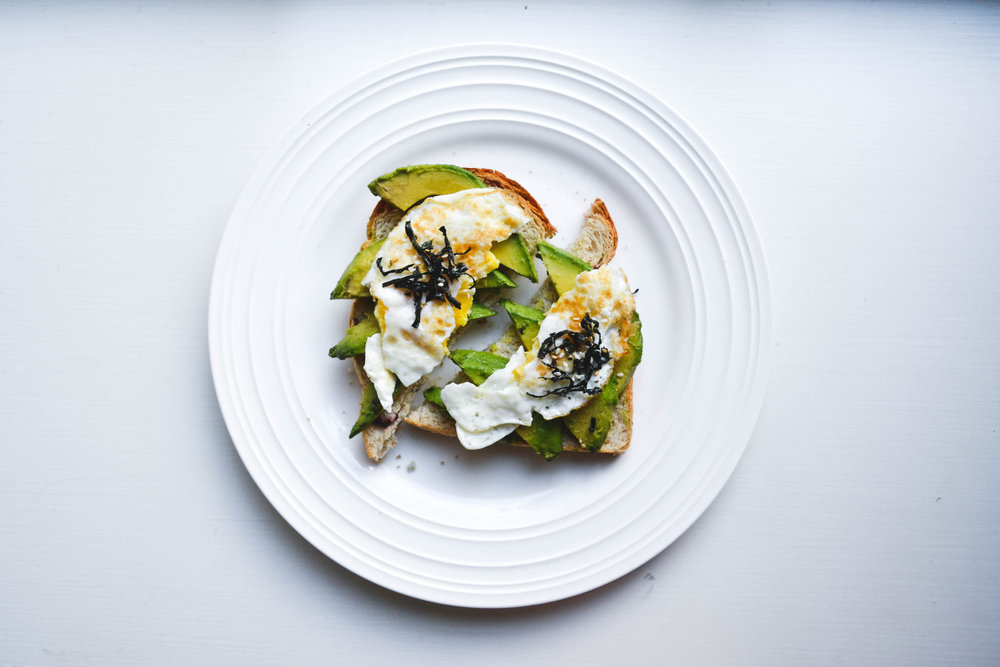 fried egg* +avocado +seaweed +pea*shoots +sesame - *try frying the egg in maple syrup.*any shoots! radish would be great too.