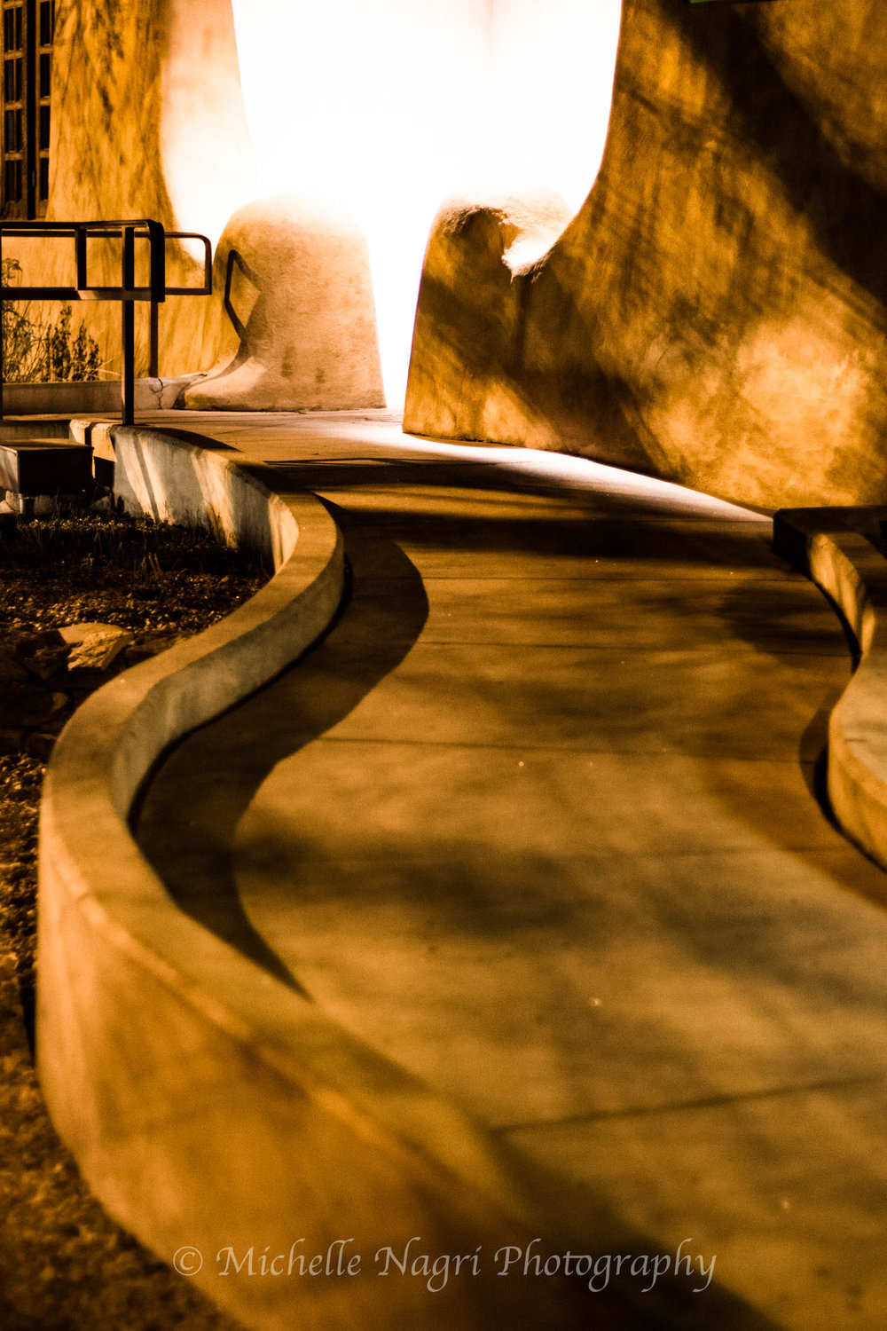 I intentionally kept the blown out light on the entryway to the New Mexico Museum of Art. The sidewalk gently curving to a bright light.