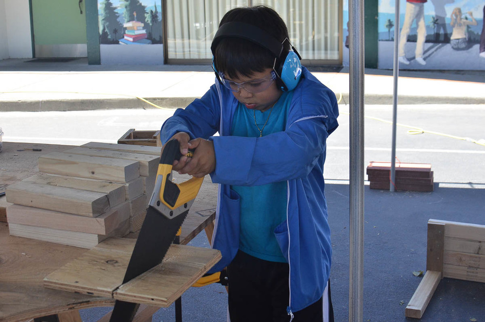 Eugene using the handsaw for part of his project.
