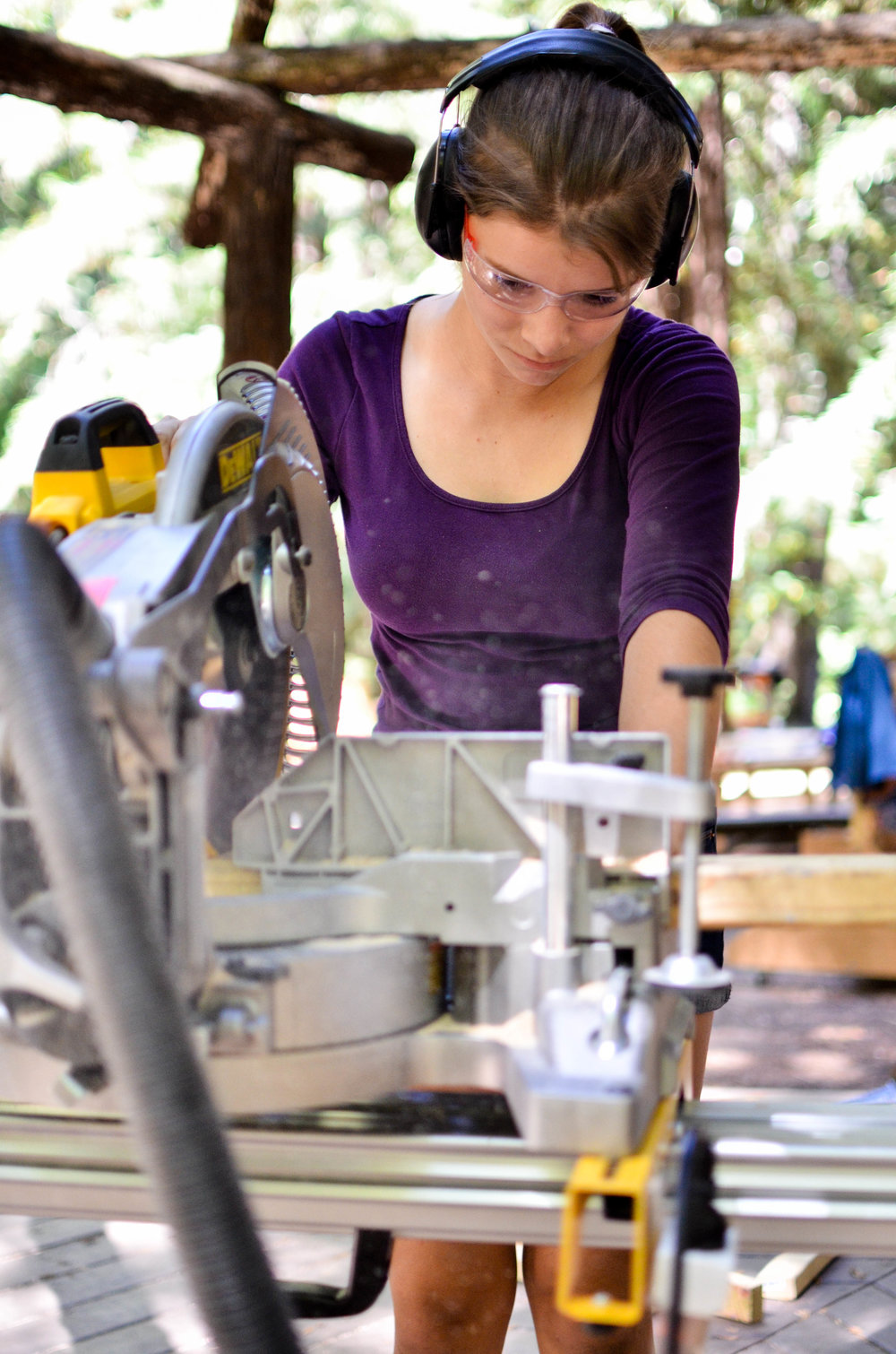 Teenage Girl uses a Chopsaw