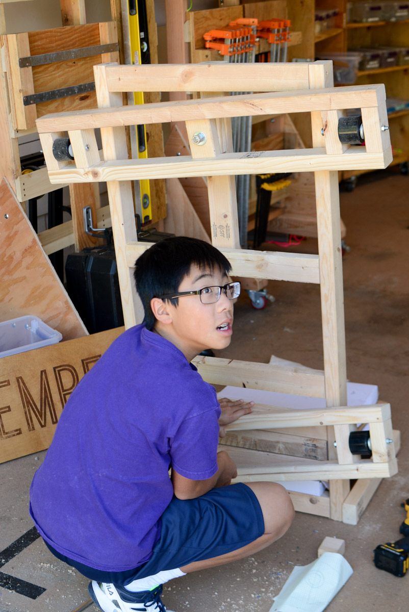 Jacob works on placement for the back fixed wheels.