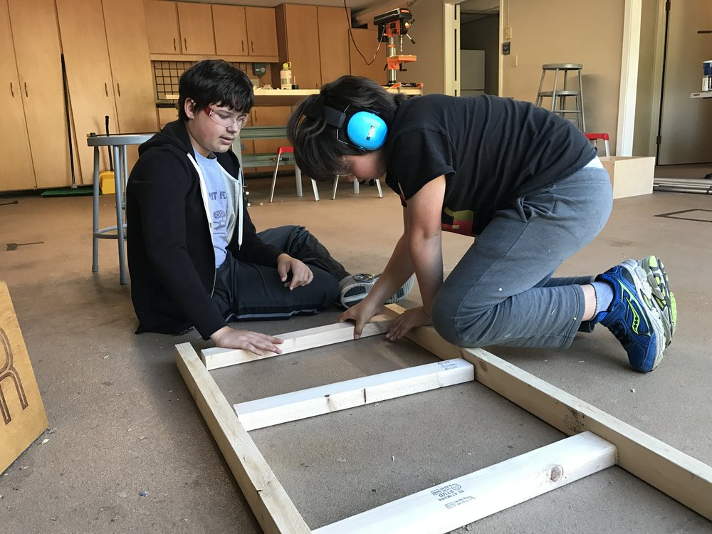 Sebastien and Victor piece together their cart's frame.