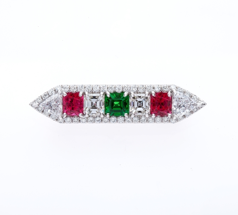 Stunning Diamond, Tsavorite Garnet and Spinel Pin; 3.37 carat total weight. Set in platinum.   All Pins are custom made and can accommodate any size stones.