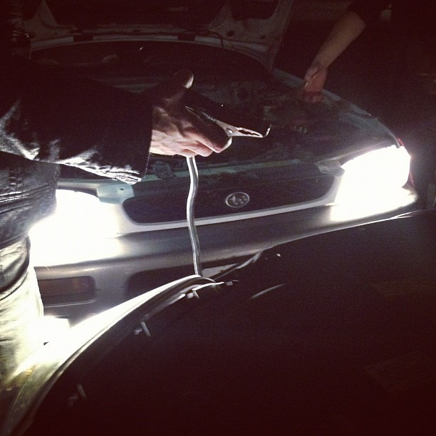 And then the car battery died…team o rock fixing it. (Taken with  Instagram )