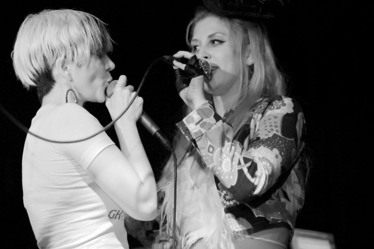 "Greta onstage with Jesika from Gram Rabbit at The Viper Room    irockphotos :     So a few weeks ago I suggested that these two great singers sing a duet together since they are friends and it would be great way to celebrate the show (It was actually a rumor I started on Facebook). To my surprise Greta gets on stage to help with the rapping duties in the song ""Candy Flip."" It was great. Here is a photo that documents this musical moment.   Greta Valenti of Well Hung Heart  and Jesika VonRabbit of Gram Rabbit singing the GR hit ""Candy Flip"" at the Viper Room September 2, 2011."