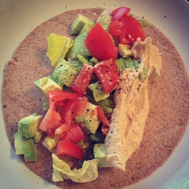 Whole wheat wrap with lettuce, hummus, avocado, tomato, sea salt, olive oil. 422 calories of goodness!