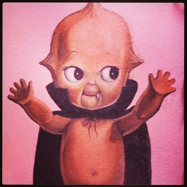 You know you're at Alex' Bar when…. #vampirebaby #snaggletooth #creepybaby #mural #womensrestroom (at Alex's Bar)