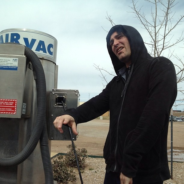 #gangsta @nicopriest freezing… I mean #rapping in the #Amarillo, TX air as he puts #air in the #tires. His new #rapname is 44psi. @therobindavey is his #hype man. #oklahoma here we come! @WellHungHeart is playing The #Vanguard in #Tulsa on Wednesday night at 9pm!!! (at Murphy Express)
