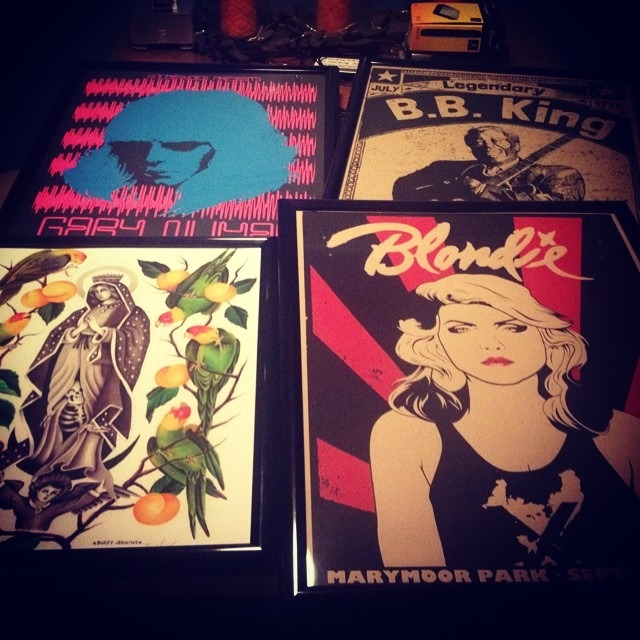 Some uh-mazing new artwork for da headquarters. 3 gorgeous official screen printed limited edition show posters from #xraydesigns available at Garageland.net !! HUGE Thank you @art_kills!! These pics do not do these posters justice! AND a print of a watercolor by amazing tattoo artist @buzzyjenkins !! Cant wait to hang these! #blondie #xtheband #x #bbking #garynuman #buzzyjenkins #silkscreen #screenprintedpostets #rockposters #tattooart #parotsoforange #watercolorprint @wellhungheart  (at GROWvision Studios)