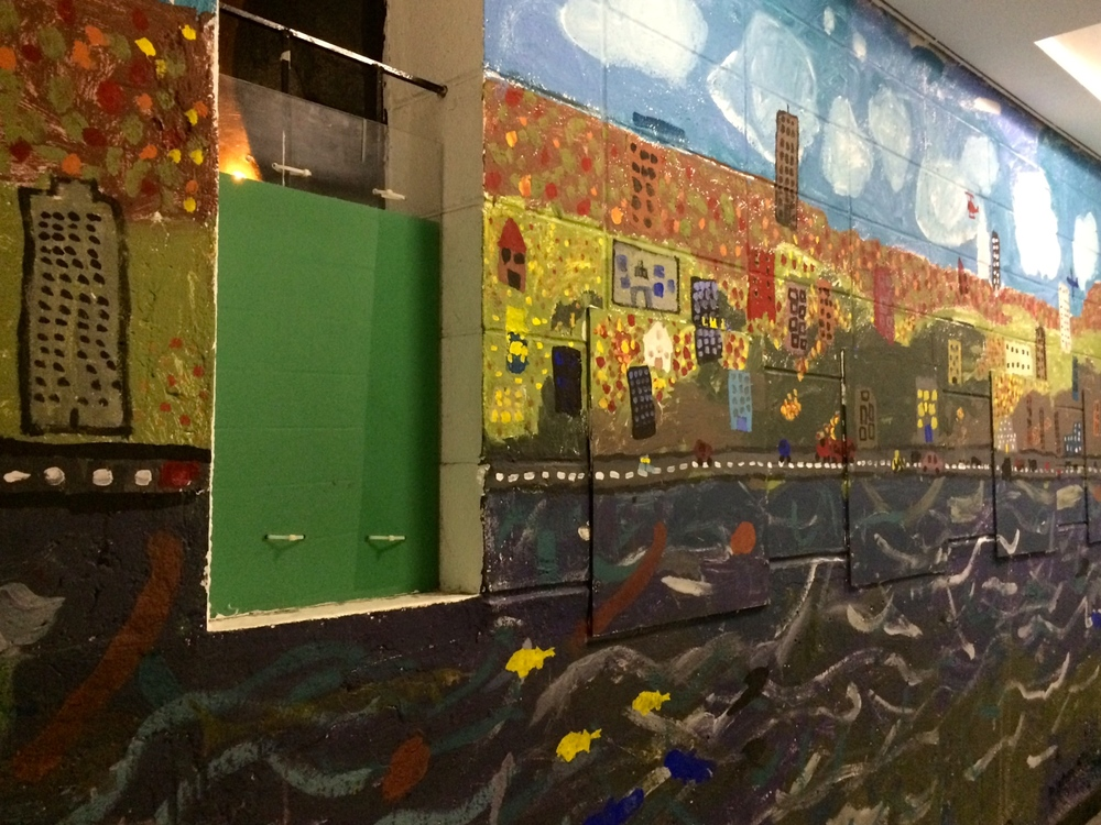 At Bank Street, one way they work with the kids to connect to their space is by allowing the students to paint murals in the stairwells.