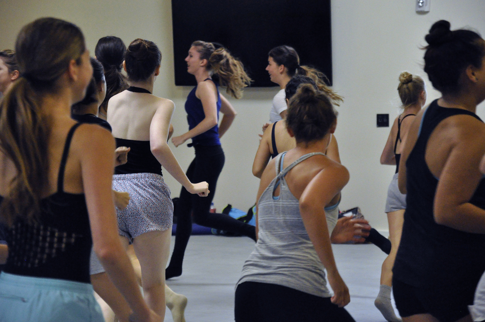 2015 participants jog around the room in a warm-up improvisation. Photo © Taryn Ka'iulani