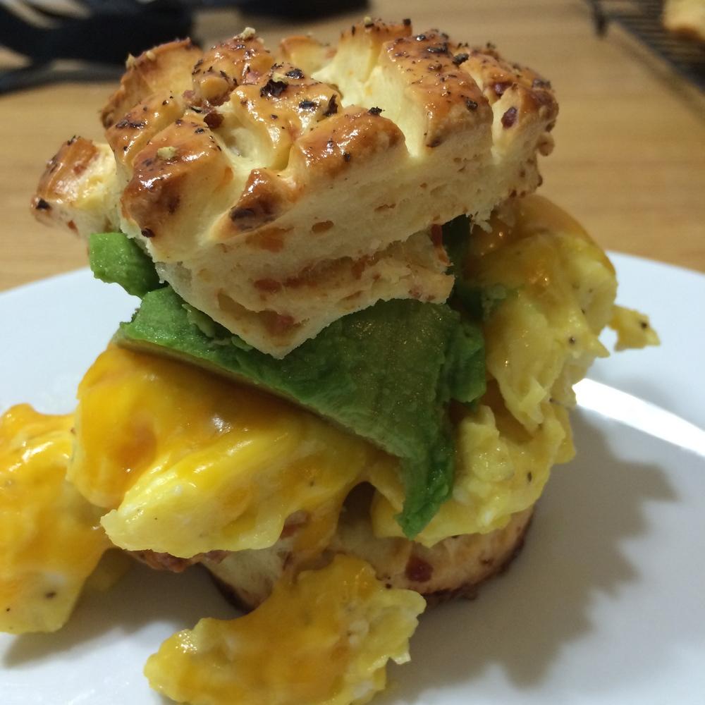 avocado, egg and cheese on pogacsa