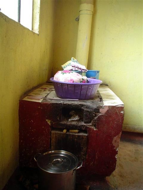 Wood stove with ventilation to the outside. Public health initiatives in Latin America and Africa work to educate and fund proper ventilation after studies revealed a correlation between early mortality from lung cancer and smoke accumulation indoors from wood stoves lacking proper ventilation.