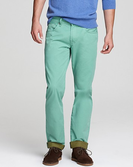 blue-green jeans with dull brown suede bucks shoes.