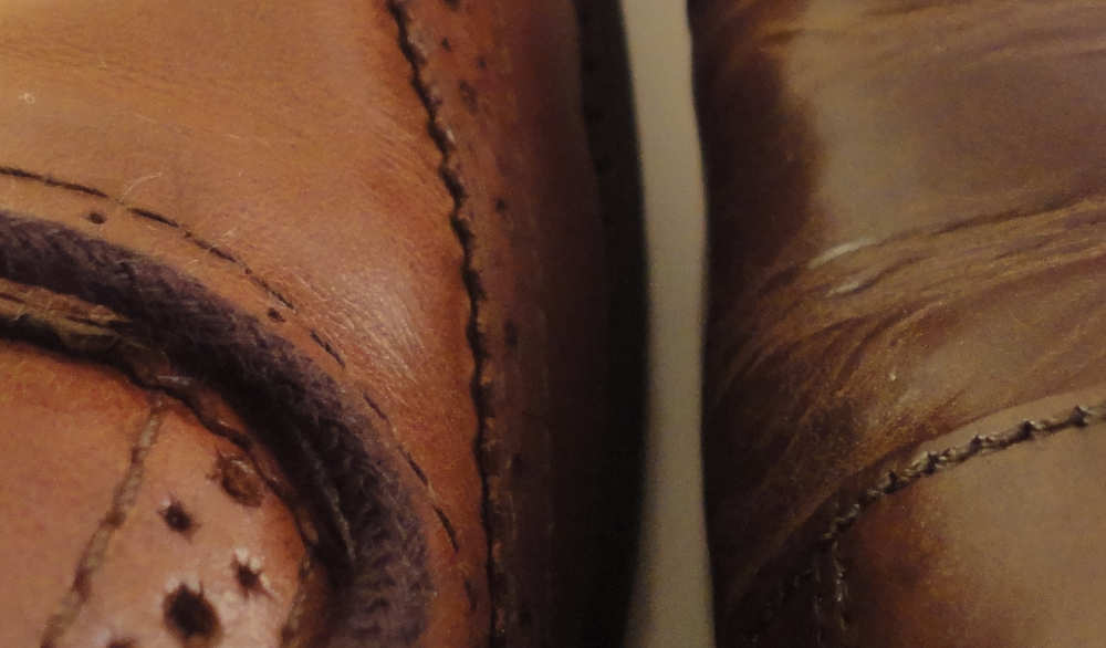 Full grain (left) VS Corrected grain (Right).  Full grain leather typically have gentle creases while corrected grain cracks (see example below)
