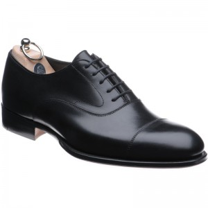 Black Oxfords. Classic with a twist. (formal - good for grooms who want a classic shoe with a subtle difference)