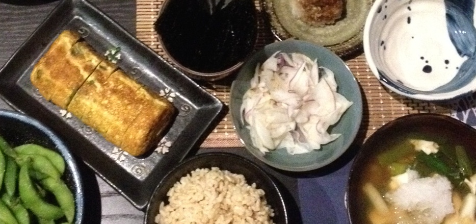 L-R: Edamame (young green soy beans); rolled omlette; rice; turnip pickles; simmered tofu
