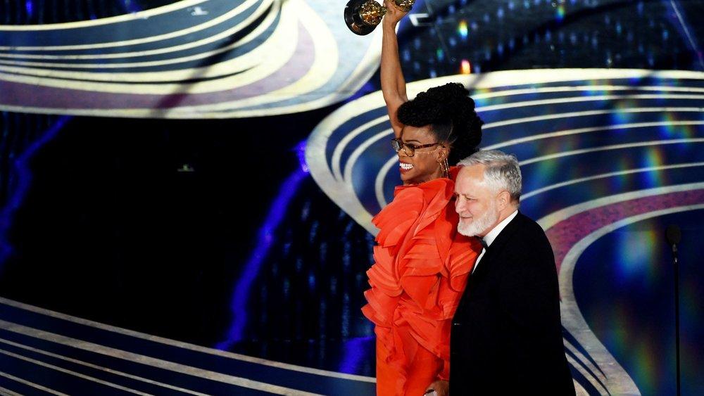 Hannah Bleacher along with Jay Heart accepting the Oscar for Best Production Design