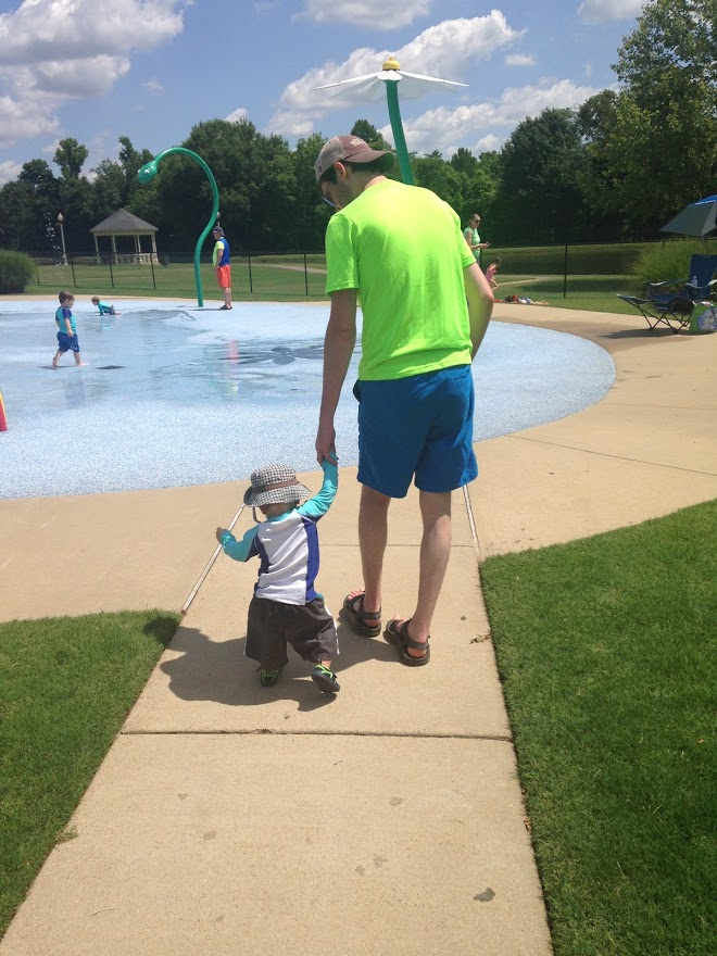 My husband and our middle son at a local splash park.
