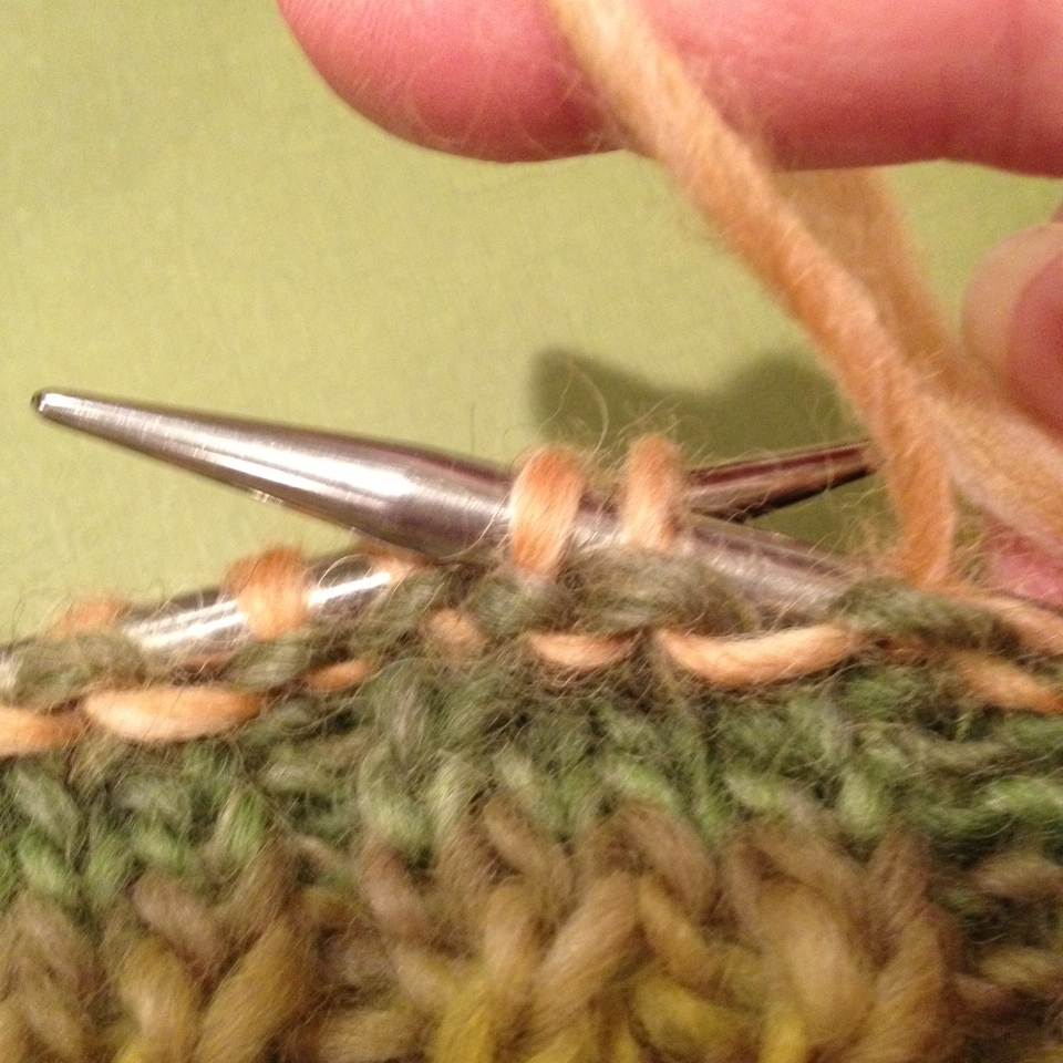 Here I am purling my Round 1, offsetting my stitch patterns and decreasing at the same time. Round 2 is just a simple purl round.