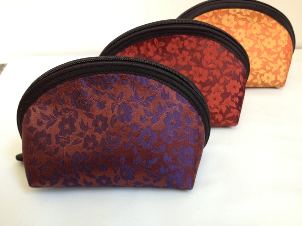 Available in the colors shown above:   Front to back: Bronze/Purple, Dark Red, Orange/Gold