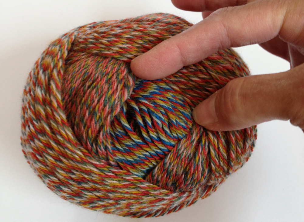 Peek inside a ball of Zauberwolle yarn to discover gorgeous gradient self-striping color changes!