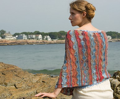 Look at   Naushon Shawl  pattern. The drop stitch design element of this pattern really shines. This fiber would also work well with a texture stitch such as the garter, seed or moss stitches.