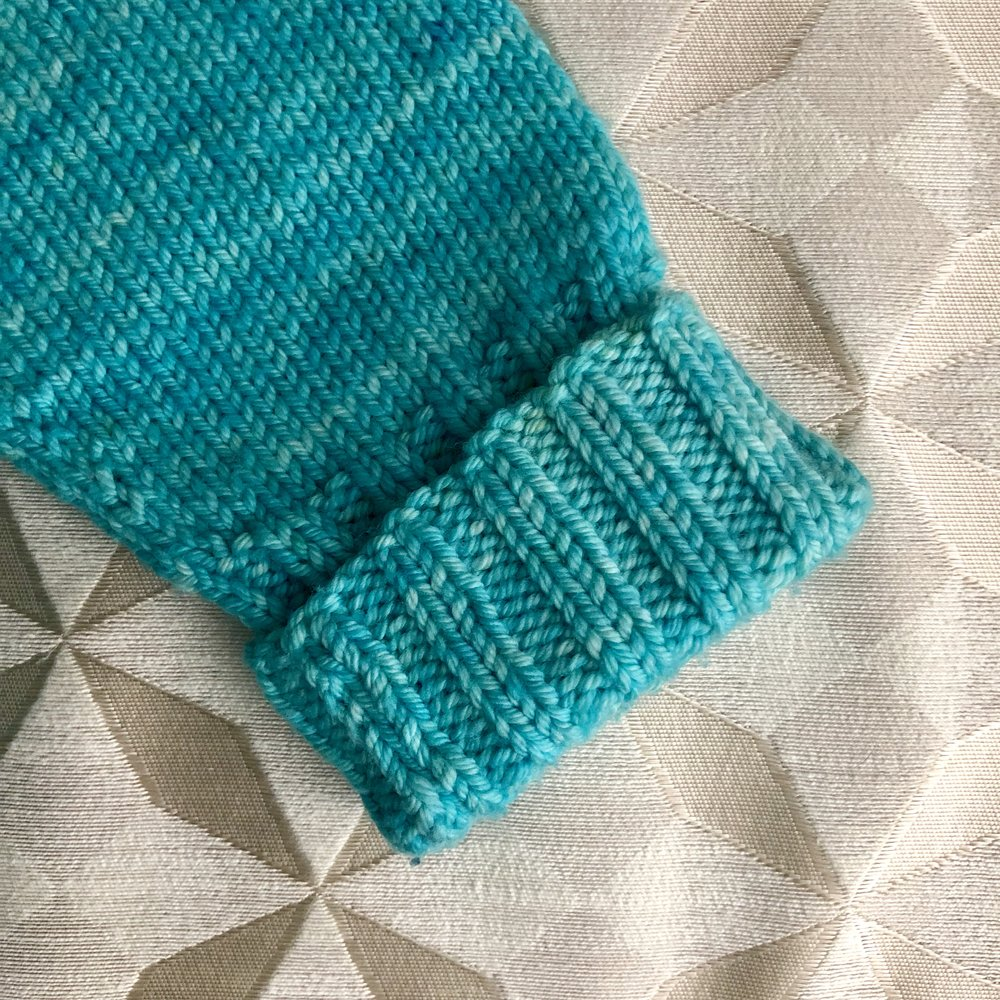 A 2x2 ribbed cuff on the Ginny Cardigan