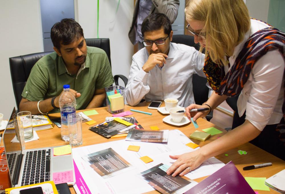 Melanie and Varad work throughlow-fi prototyping methodsin Bangalore.