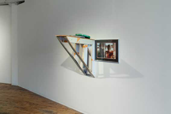 Jesse Butcher,  Concealable, Removable, Available, Valuable, Enjoyable and Disposable , 2013. Wood, latex paint, aerosol paint, polyurethane, educational films, framed photograph, hardware. 29 x 29 x 30 inches