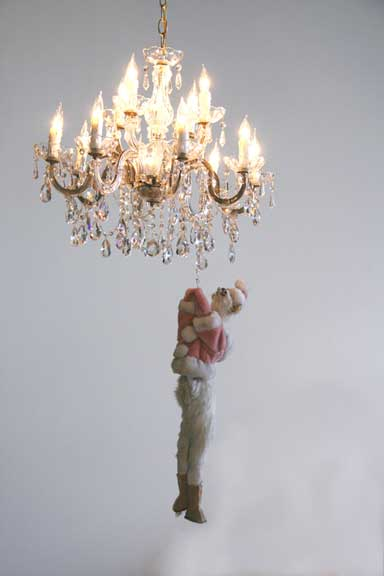 April Childers,  Its Almost Friday (Hang On Kitty) , 2009. Chandelier, lights, taxidermied cat, motor, kitty clothing. Dimensions variable.