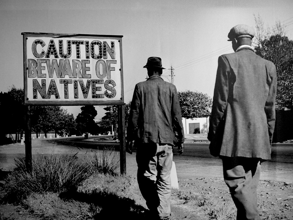 apartheid and capitalism In fact, the expansion of capitalism and freer international trade has coincided with an era of slow economic growth, high unemployment, increased child labor, skyrocketing inequality, and grinding poverty.