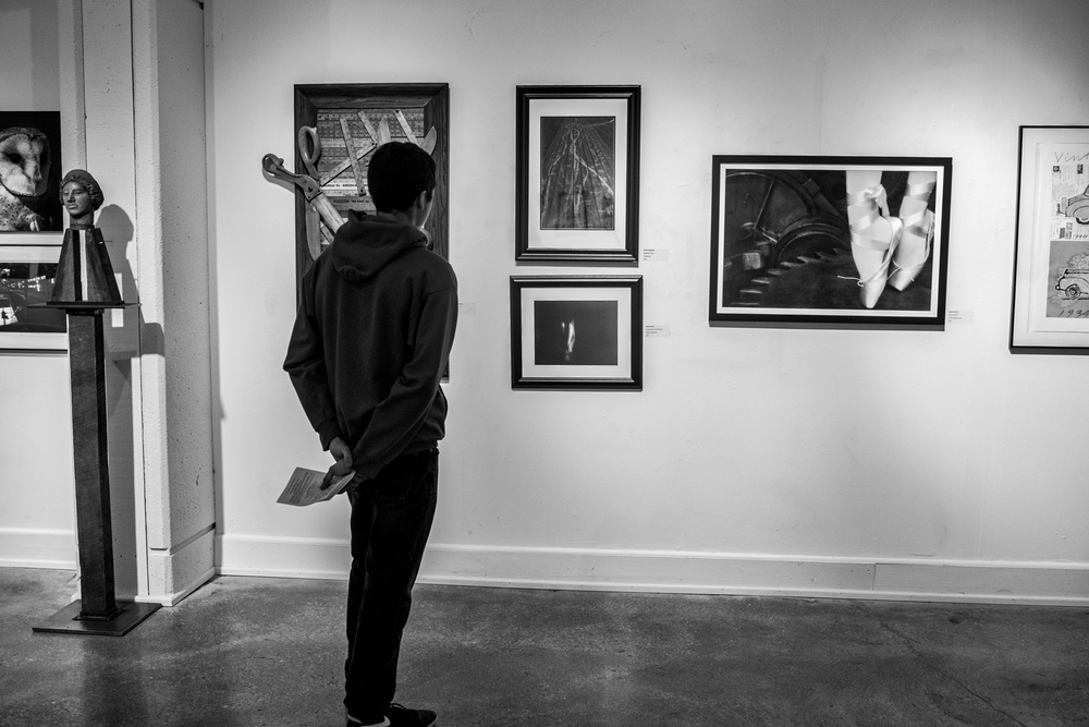 A big moment for me. My son is looking at my art hanging on a local museum's wall in my very first juried art exhibition.