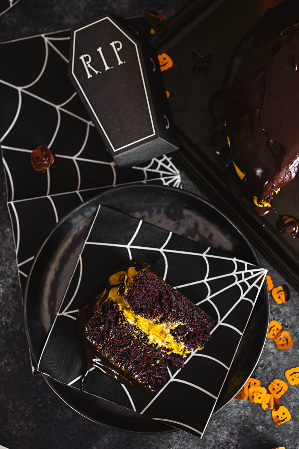 """Vegan Halloween Recipe: deliciously fluffy and moist Chocolate & Pumpkin Cake, frosted with an Orange Cashew """"Buttercream""""."""