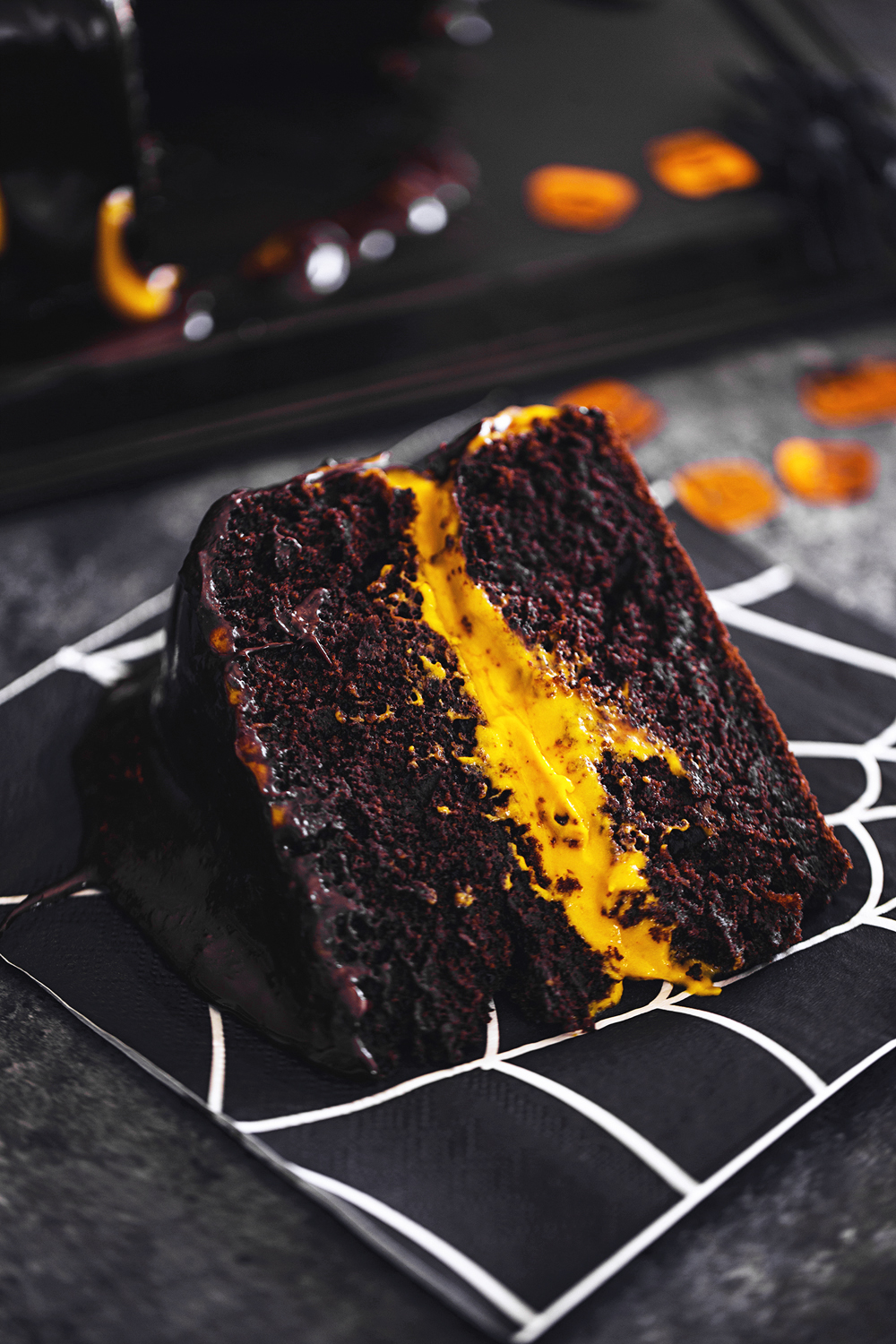 "Vegan Halloween Recipe: deliciously fluffy and moist Chocolate & Pumpkin Cake, frosted with an Orange Cashew ""Buttercream""."