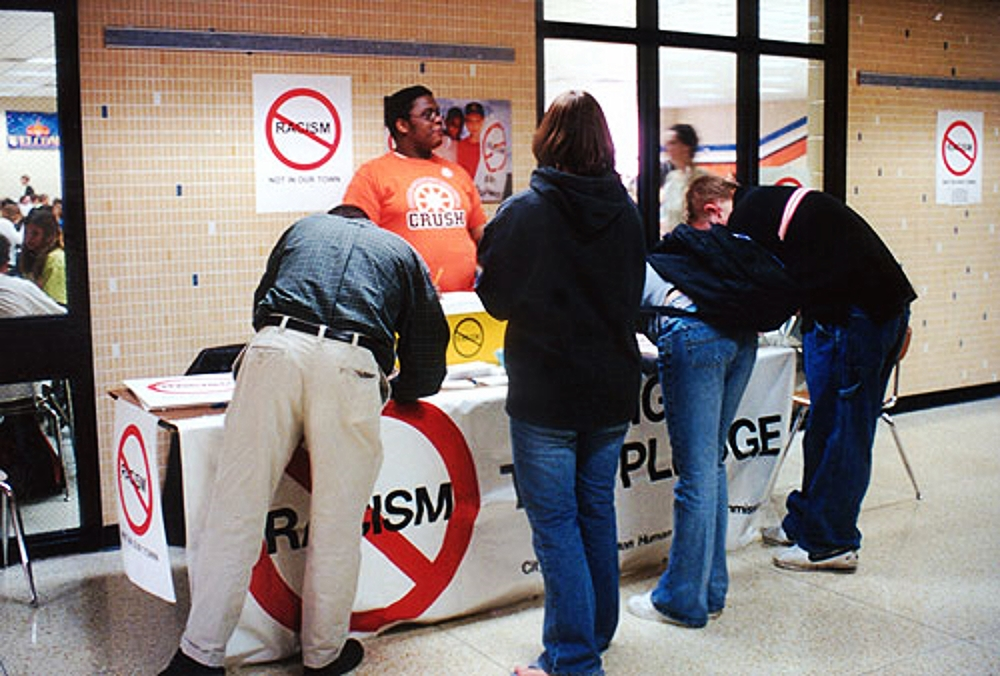 A pledge card-signing drive in the Normal Community High School cafeteria atrium.
