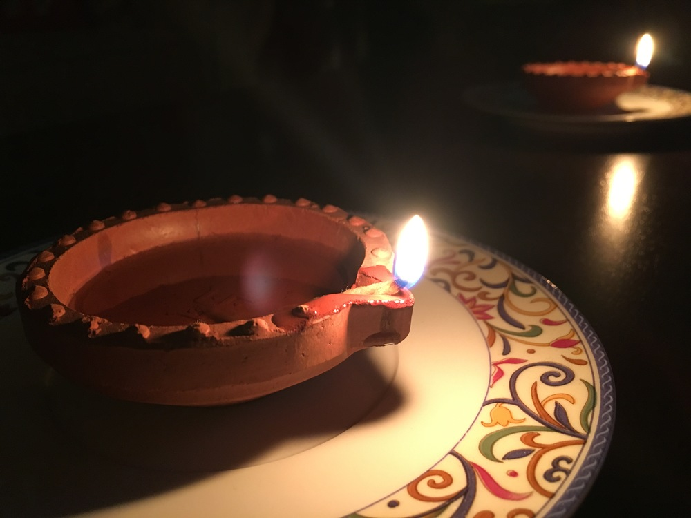 Oil lamps used in Deepavali celebrations are lit in earthenware pots. People do use candles but oil lamps are usually preferred.