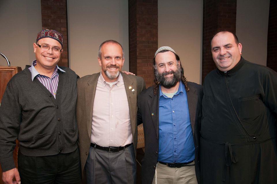 From left, Sheikh Ghassan Manasra, Michael Gizzi, Rodef Shalom Eliyahu McLean, Deacon Jiries Mansour, during a recent interfaith dialogue at ISU.