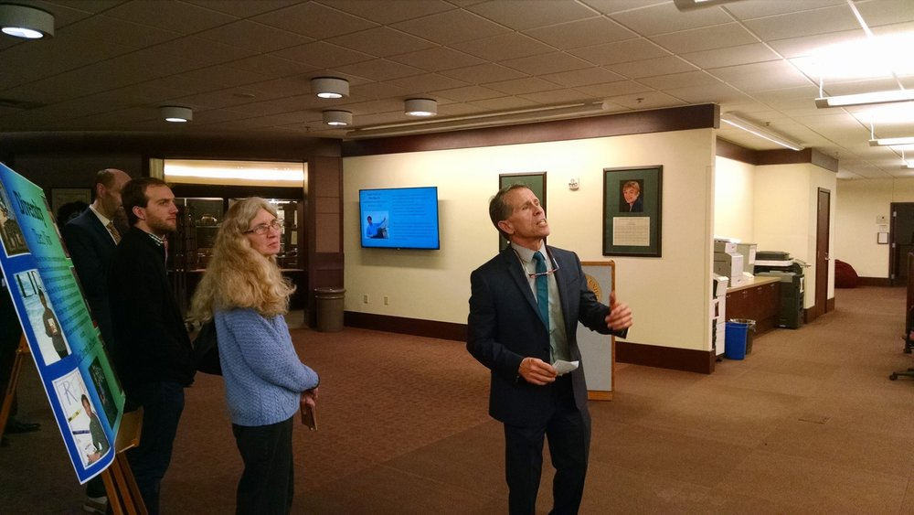 Mayor Tari Renner eyes the exhibit.
