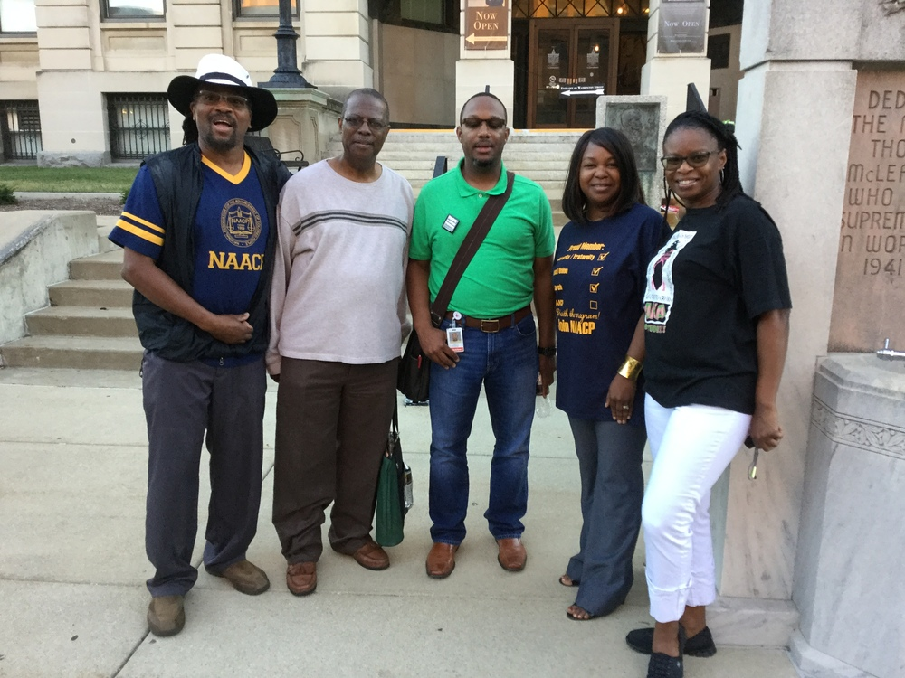 Cummings, center, with local NAACP representatives at NIOTBN's 20th anniversary celebration in downtown Bloomington June 28.