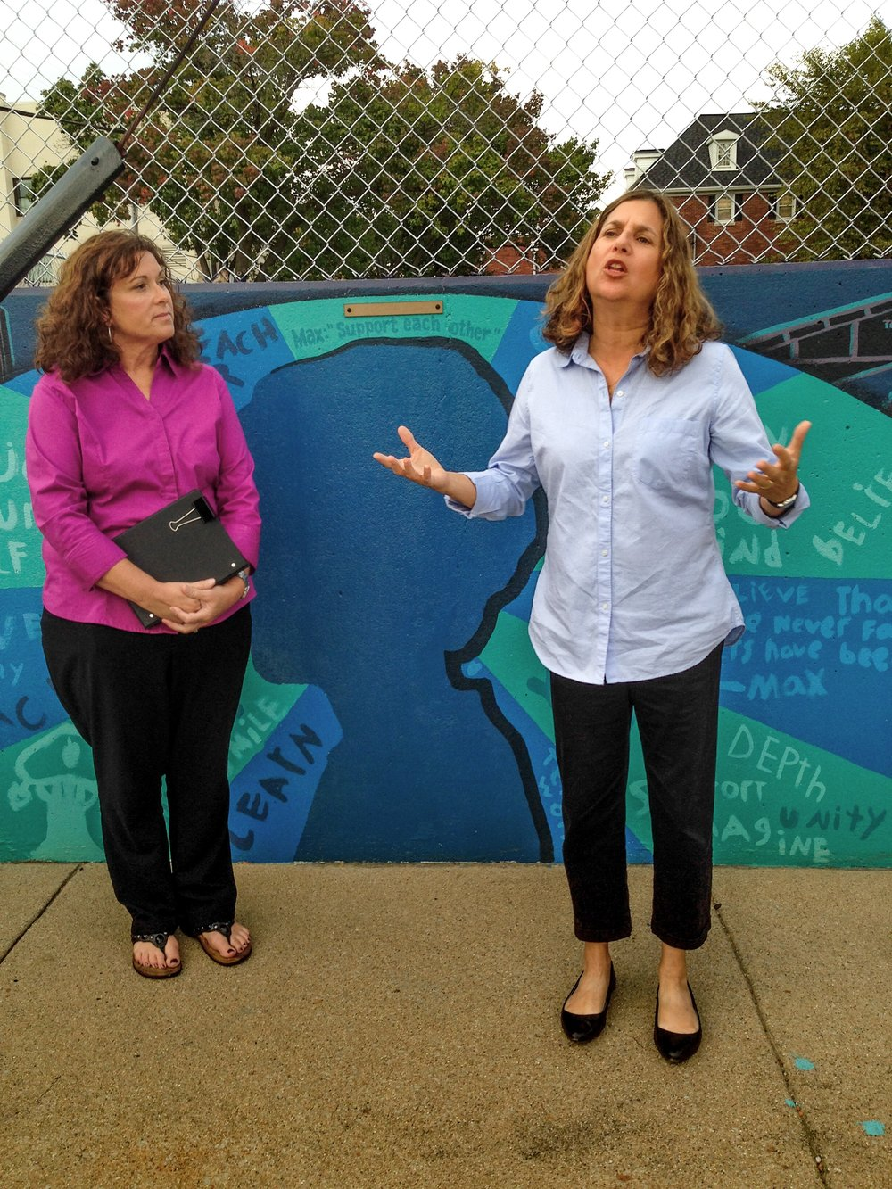 Moses Montefiore Congregation Rabbi Rebecca Dubowe, right, offers a blessing for the mural along with Bloomington First Christian Church Rev. Kelley Becker.