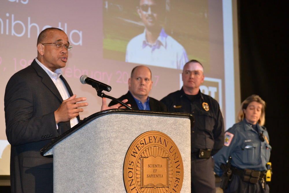 Bloomington Police Chief Brendan Heffner and local law enforcement officers were on hand at the event. Below, Normal Mayor Chris Koos, right, and Bloomington Mayor Tari Renner stress the need for community solidarity.